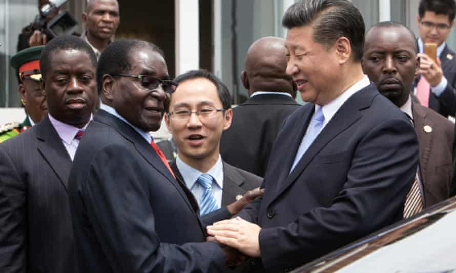 China's president, Xi Jinping, shakes hands with his Zimbabwean counterpart, Robert Mugabe, in Harare in 2015.