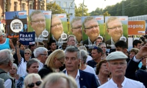 Supporters hold placards backing CDU candidate Frank Henkel in the run-up to Sunday's state elections in Berlin.