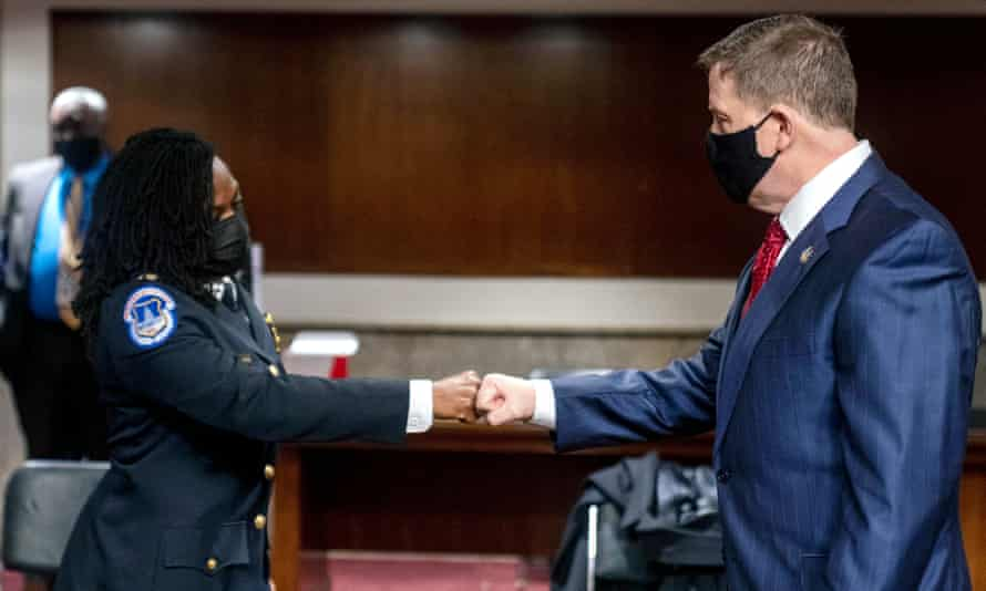 Steven Sund greets Capt Carneysha Mendoza of the Capitol police before they testify before the Senate hearing