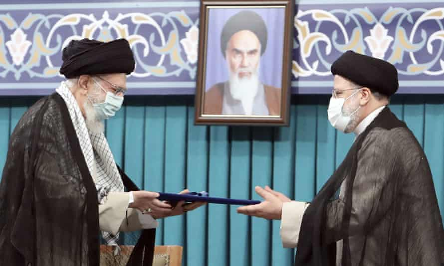 Ayatollah Ali Khamenei, left, gives his official seal of approval to Ebrahim Raisi in Tehran, Iran on 3 August.