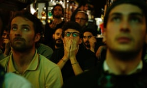 Italy's supporters react at the end of the World Cup playoff with Sweden.