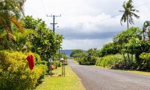 Red flags are seen hanging outside of homes of Apia residents indicating they have not been vaccinated for measles