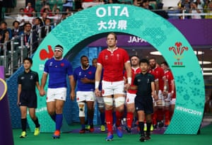 Guilhem Guirado of France and Alun Wyn Jones of Wales lead the teams out.