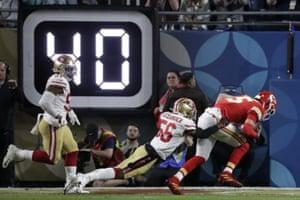 Kansas City Chiefs quarterback Patrick Mahomes scores past San Francisco 49ers' Kwon Alexander during the first half.