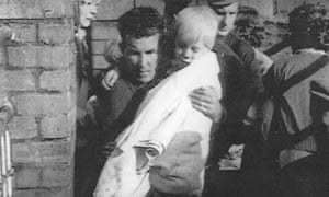 Jeff Edwards, eight, rescued from the rubble of Pantglas junior school. October 1966.