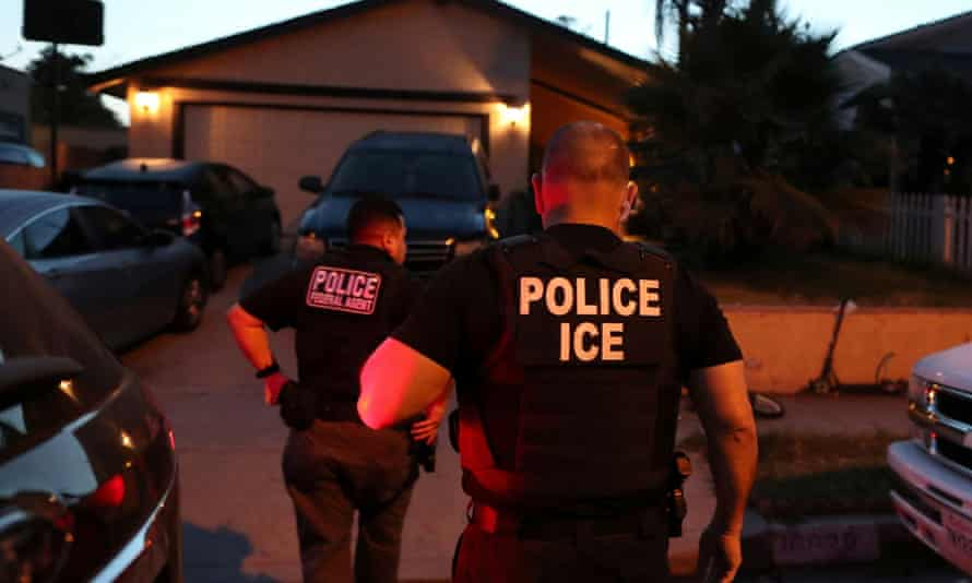 An Ice team arrives to arrest an immigrant at a home in Paramount, California, 1 March 2020.