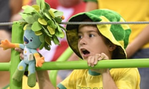 A young Brazilian fan holding the Rio 2016 Paralympic Games mascot Tom