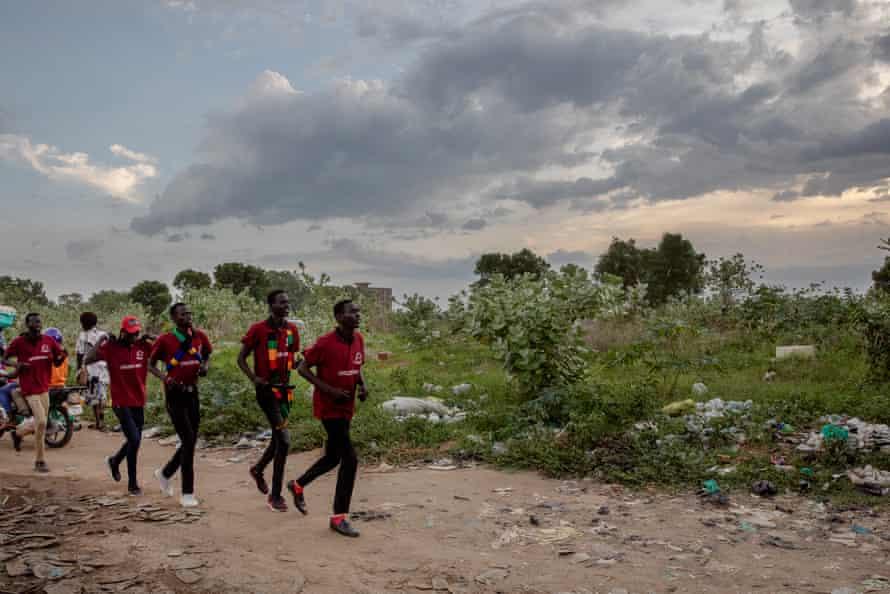 Dinka men on their way to a gathering