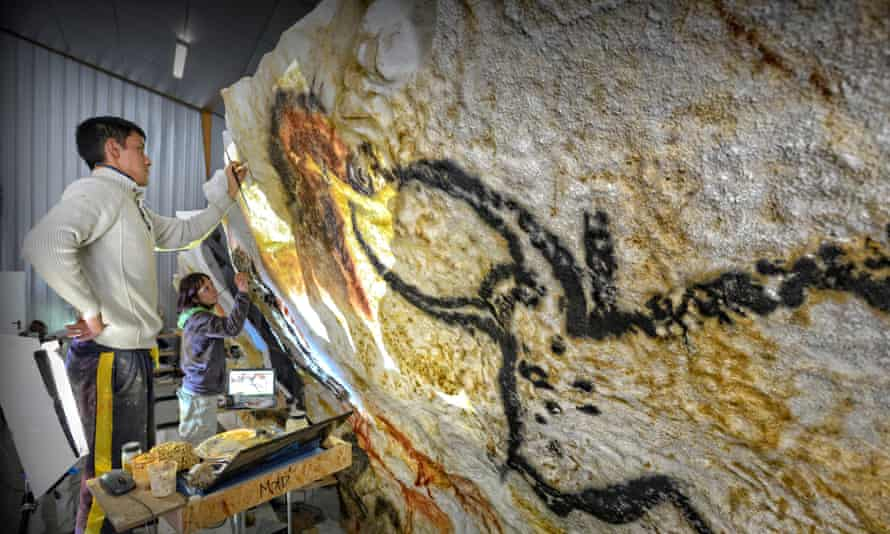 Artists at work on the cave art replica at the International Cave Art Centre.