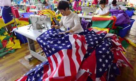 A woman sews American flags in a Chinese factory