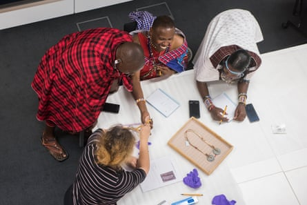 Diplomacy … Samwell Nangiria, second right, and fellow Maasai explain an object's significance to curators.