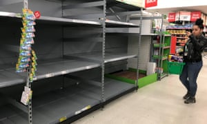 Empty shelves where toilet roll is usually stocked in an Asda store in Clapham Junction, London.
