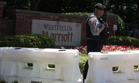 A police officer stands guard at the entrance of Westfield Marriott Hotel, where the Bilderberg conference took place.