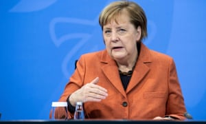 Angela Merkel announcing the new measures on Sunday.