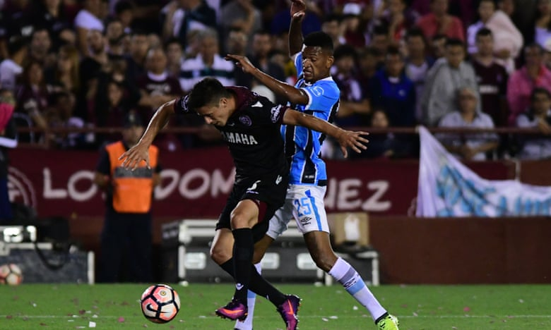 Rolando Garcia Guerreño of Lanus and Jailson of Gremio fight for the ball during the Copa Bridgestone Libertadores 2017 final.