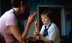 Teacher with deaf pupil in classroom