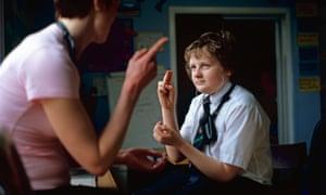 Teacher with deaf boy