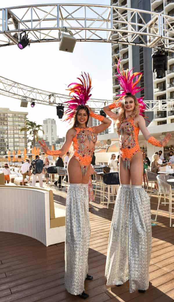 Performers on stilts pose at the opening weekend of Cali Beach club.