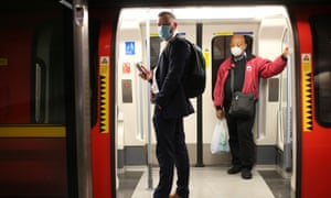 Passengers wear face masks on a London Underground Tube train during the evening rush hour on 11 May 2020.
