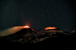 A night view of the south-east crater complex and the intra-crater of the Bocca Nuova and Voragine crater complexes during explosive activity