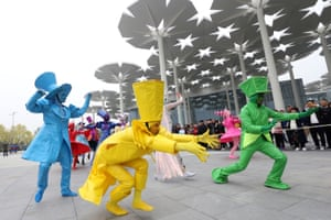 Performers dressed up in costumes perform on the first day of horticultural exhibition.