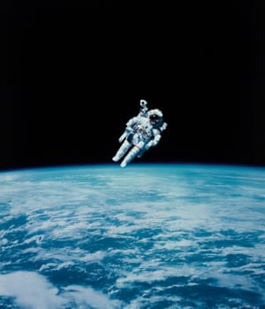 Bruce McCandless II performing the first untethered spacewalk 1984,