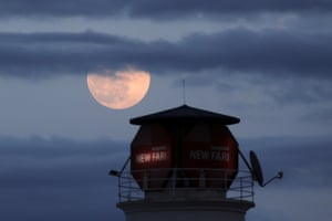 The supermoon near a lighthouse in Tirana, Albania.