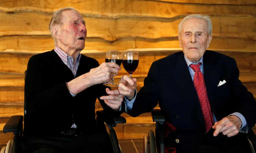 Paulus and Pieter Langerock from Belgium toast themselves on their 103rd birthday.