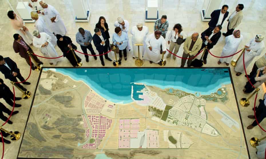 Investors examine a map of future plans for Duqm.