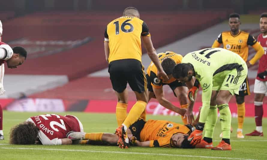 Arsenal's David Luiz and Wolves' Raúl Jiménez after their clash of heads