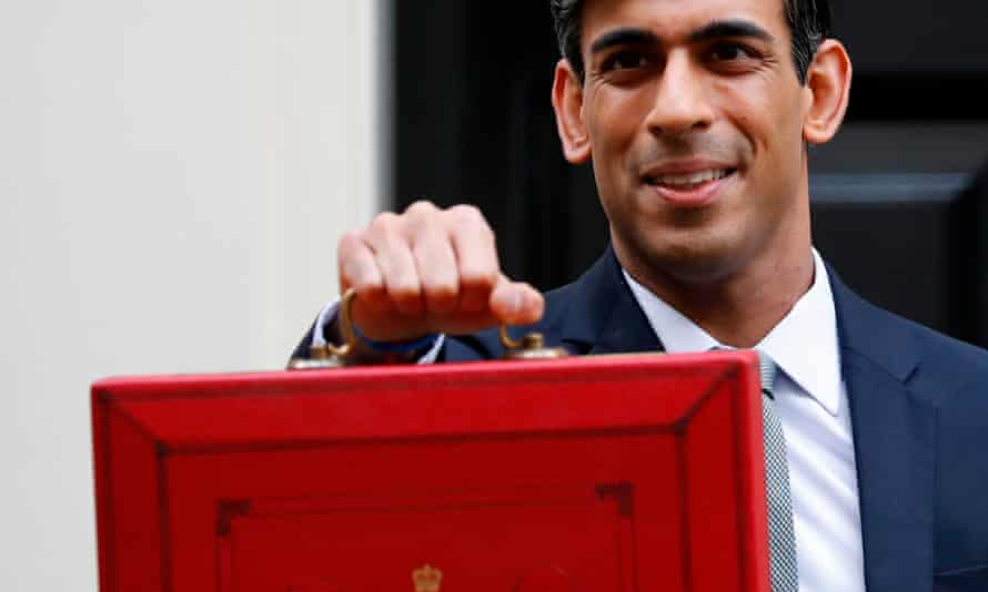 Rishi Sunak prepares to announce his budget in March 2020. He has said he intends to withdraw the extra £20 paid to families claiming universal credit.