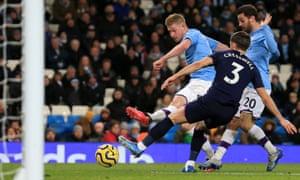 Kevin De Bruyne (centre) scores Manchester City's second goal against West Ham.