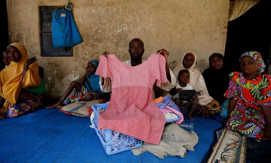 Kachalla Bukar with a blue plastic basket containing his 14-year-old daughter's belongings. Aisha Kachalla is one of 110 girls abducted on 19 February by suspected Boko Haram militants from her school in Dapchi, a dusty, remote town in the north-eastern Nigerian state of Yobe