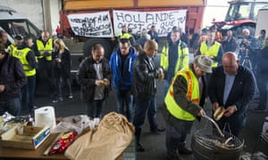 Farmers, business owners and local residents barbecue sausages during a blockade of the main road into the port.