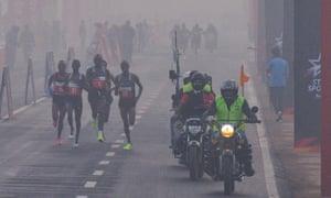 Participants make their way along Rajpath during the Delhi half marathon