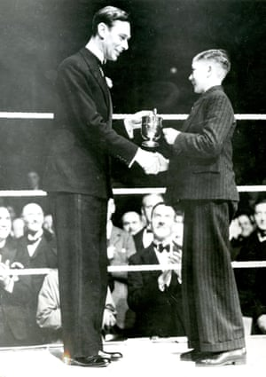 HM King George VI presents a trophy at London Federation of Boys' Clubs Annual Boxing Championships in March 1938
