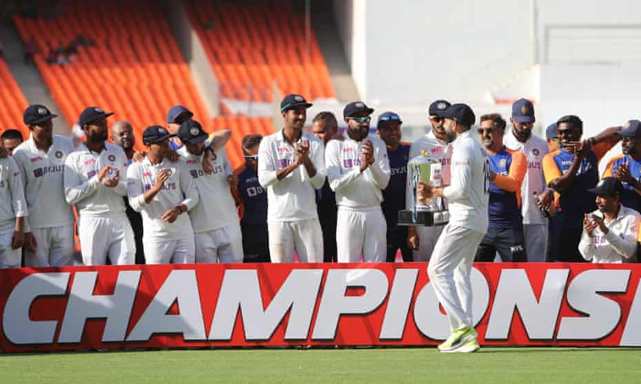 Virat Kohli and his India teammates celebrate after their victory over England.