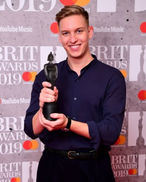 George Ezra with the award for British male solo artist.