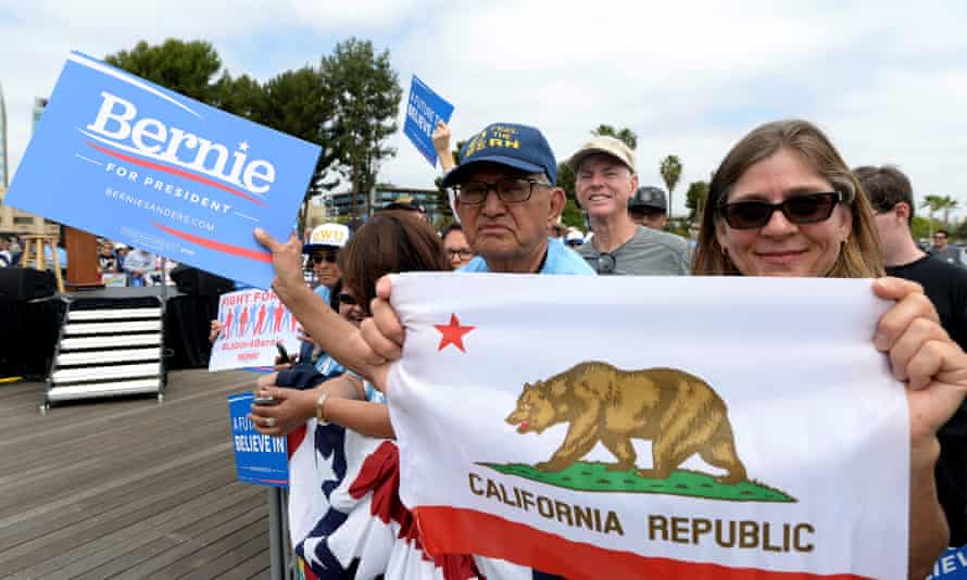 Bernie Sanders wait for their candidate to arrive for a campaign event in San Pedro, California, on Friday.