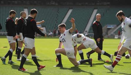 Owen Farrell stretches during the England captain's run at Twickenham on Friday.