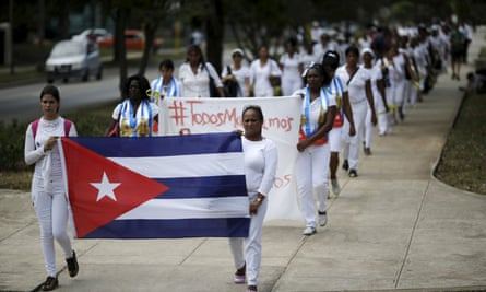 Members of a dissident group, Ladies in White, march in Havana in 2016.