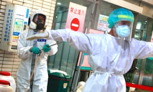 Military officers disinfect medical workers at a rapid Covid testing centre, as Taiwan adds 333 domestic cases and 2 imported cases, a record high number that jumps from Sunday's figure.