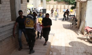 Wounded people are brought to a hospital after airstrikes carried out by Assad regime planes in Idlib