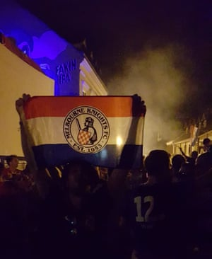 A Melbourne Knights flag is held aloft during Croatian World Cup celebrations in Zagreb.