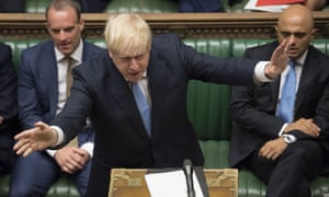 Boris Johnson in the House of Commons yesterday, with Sajid Javid (right) and Dominic Raab sitting beside him.