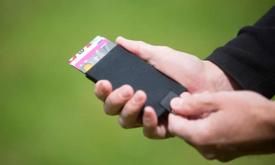 Dane Whitehurst, creative director of Burgopak, demonstrates his 'magic wallet'