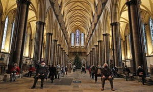 People sitting in Salisbury cathedral today, after after receiving a dose of a Covid-19 vaccine at the vaccination centre set up in the building.
