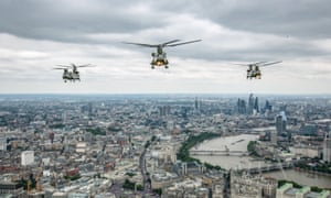 Military helicopters fly over London as they head for the flypast.
