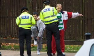 Police search two men in Springburn, Glasgow. The city has stop-and-search rates nearly 19 times higher than those in Manchester.