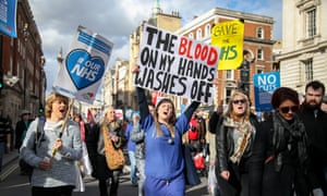 NHS workers and members of the public march against the Tory government's programme of cuts in NHS in 2017.